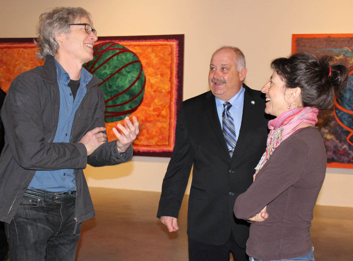 Artist Gary Spearin having conversation in the exhibition space.