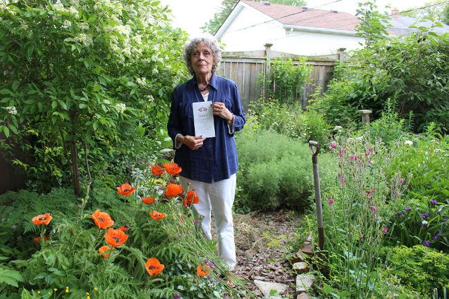 coordinator of the Communities in Bloom, Barbara Toye in a backyard garden.