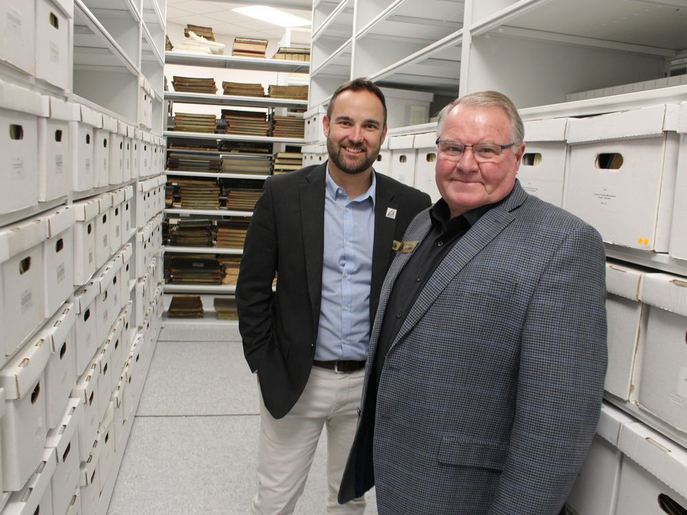 General Manager, Andrew Meyer in County of Lambton Archives with Warden, Bill Weber
