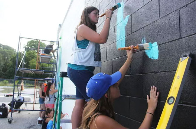 Youth painting mural