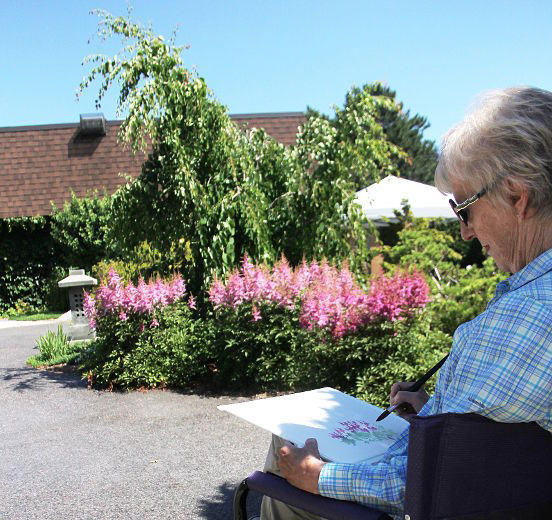 Artist Janet Morris paints the scene in the Japanese meditation garden at the entrance to Germain Park Saturday. She was one of eight artists painting in the Communities in Bloom Artists in the Garden Tour.