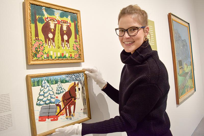 Curator, Sonya Blazek with Maud Lewis paintings