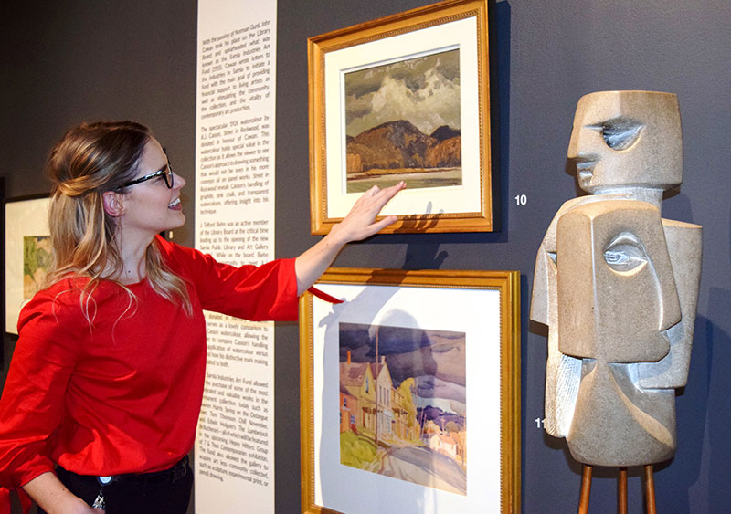 JNAAG Assistant Curator Sonya Blazek discusses a Group of Seven painting by A.J. Casson that is being exhibited for the first time.