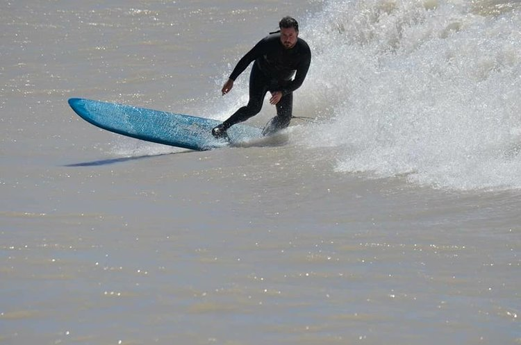 James Kirkpatrick surfing