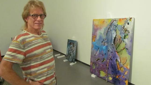 Artist Gary Nixon with his work