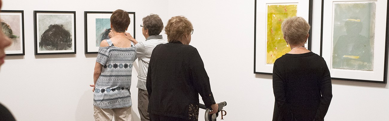 Visitors view an exhibition at the Judith & Norman Alix Art Gallery